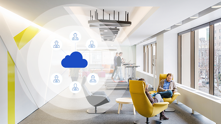 Image of informal seating in office with graphic icons overlaid to denote virtual colocation of teams is possible with design collaboration software