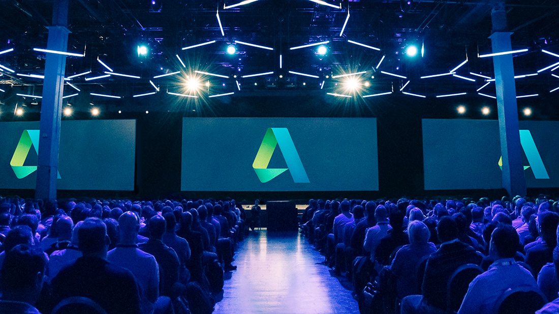 Image of stage at Autodesk University in Las Vegas from the center aisle, used as the featured image for blog post on the Project Delivery Tailored Experience at AU 2017.