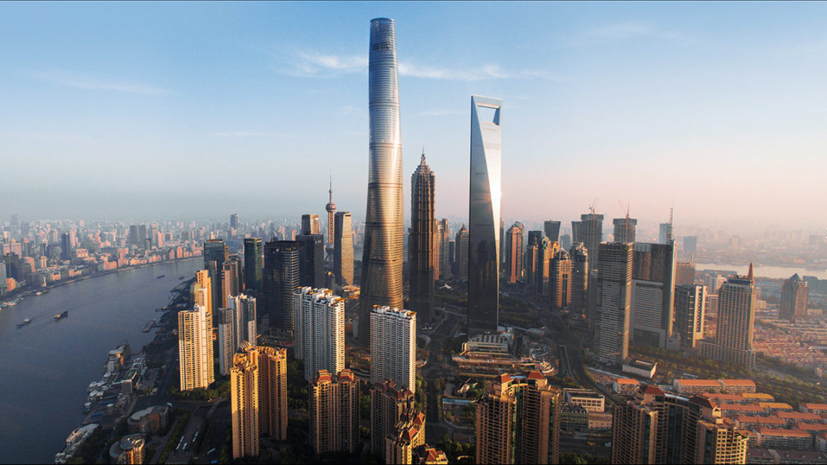 Photo of the Shanghai Tower, an example of combining integrated delivery and resilient design. The rotary plan and twisting shape of the building are both, culturally symbolic to China and saved 24% of structural material required to build this form. The strongest lateral forces in supertall buildings come from the wind, so the rounded, tapered form avoids presenting a flat face and produced significant structural savings. Biomimicry at its best! Courtesy of Gensler.