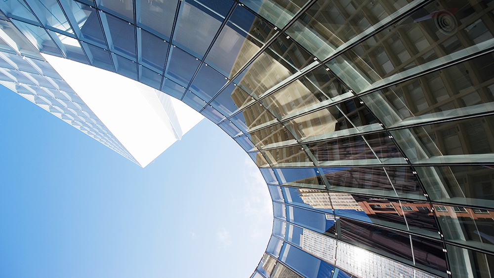 Image of curving facade on a skyscraper. AEC Industry Trends: BIM leading the future of building